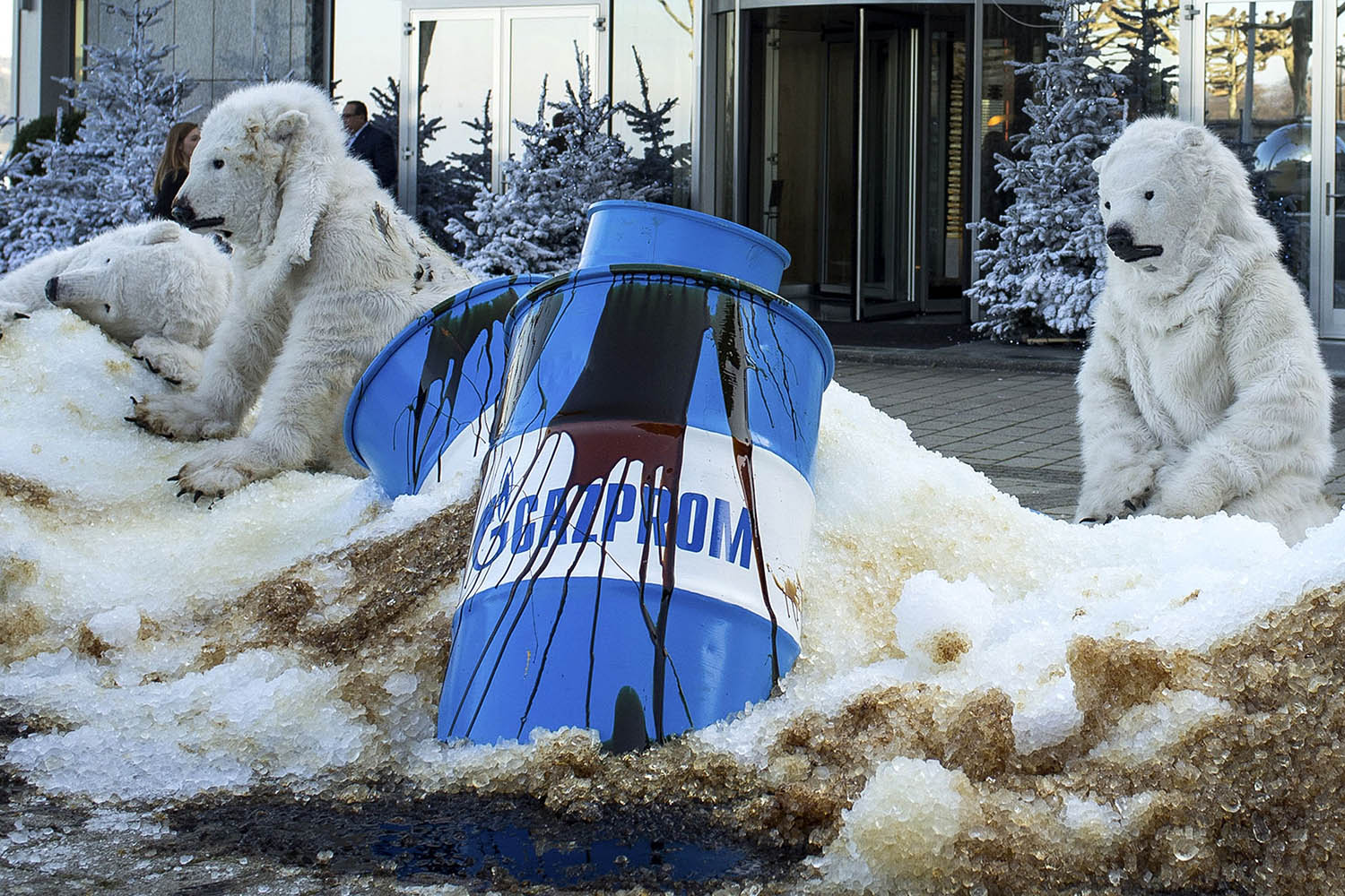 Dec. 3, 2013. This photo released by Greenpeace shows activists disguised as polar bears during a protest against Gazprom in Geneva.