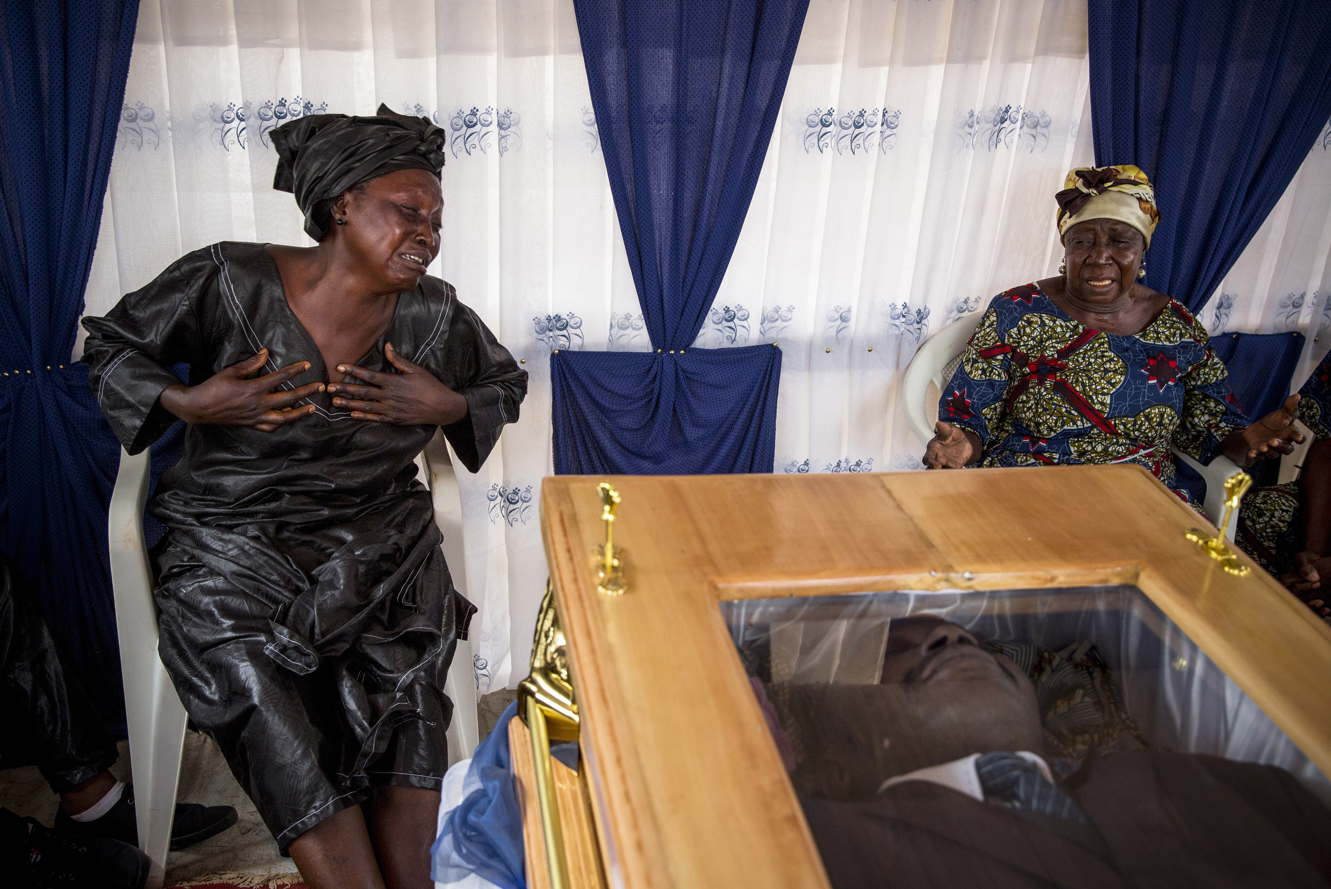 Nov. 29, 2013. Mourners at the magistrate's funeral.
