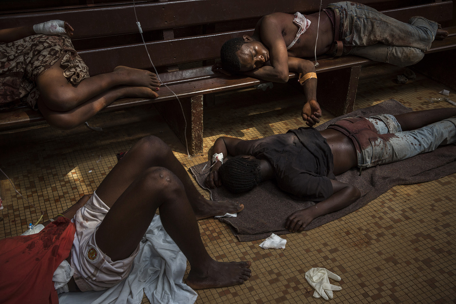 Dec. 5, 2013. Wounded Christians and Muslims at the community hospital in Bangui. Aid workers and medical staff treated roughly 100 victims, and around 50 bodies were brought to the hospital on this day.
