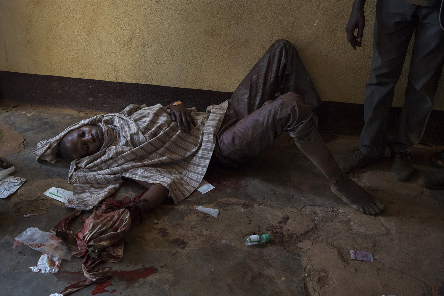 Dec. 5, 2013. A man who sustained wounds by a machete awaits treatment at the mosque.