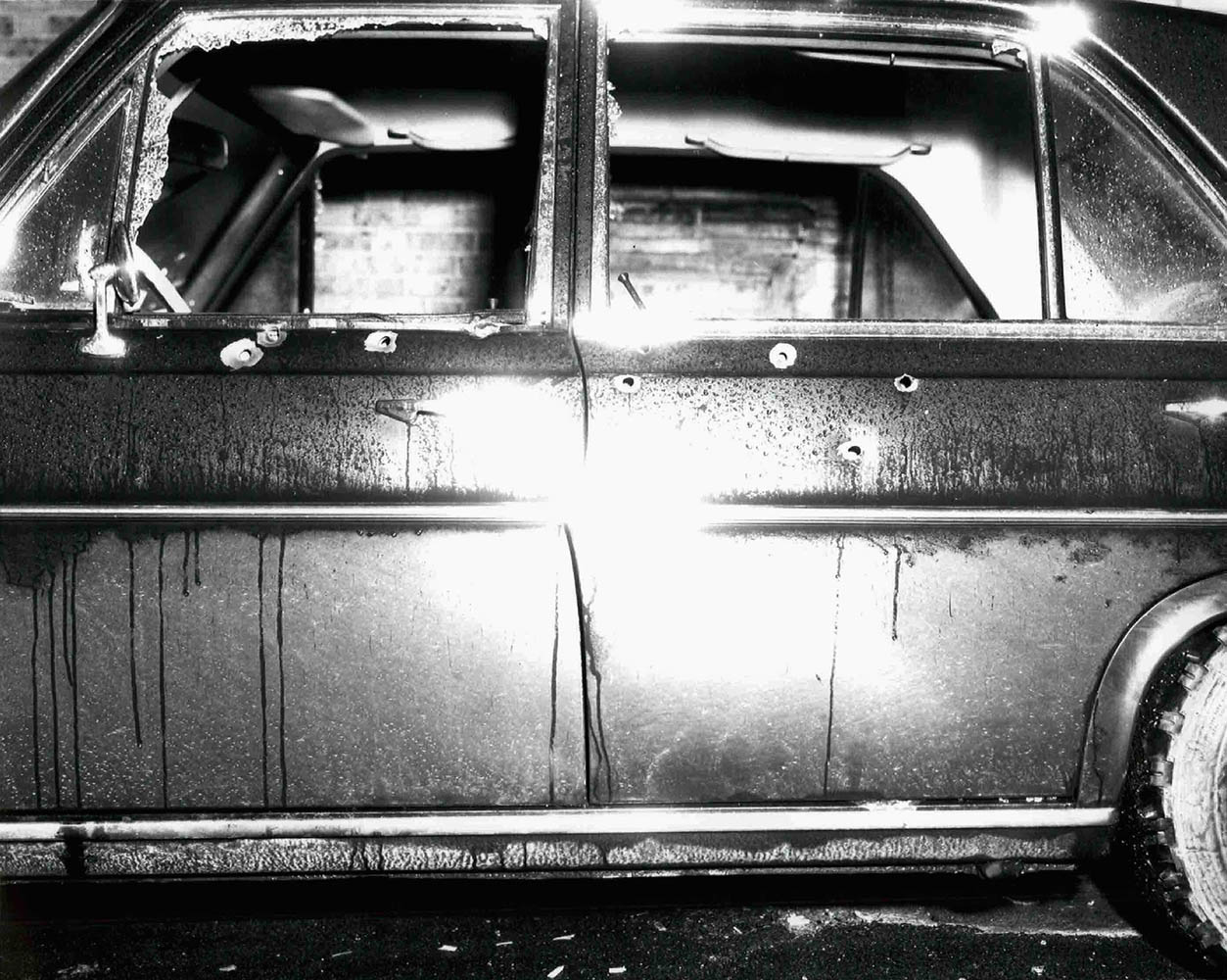 Undated. This photo provided by the U.S. Attorney's Office on June 17, 2013 shows a vehicle with bullet holes and broken glass which was shown to jurors hearing the racketeering and murder trial of accused Boston mob boss James  Whitey  Bulger.