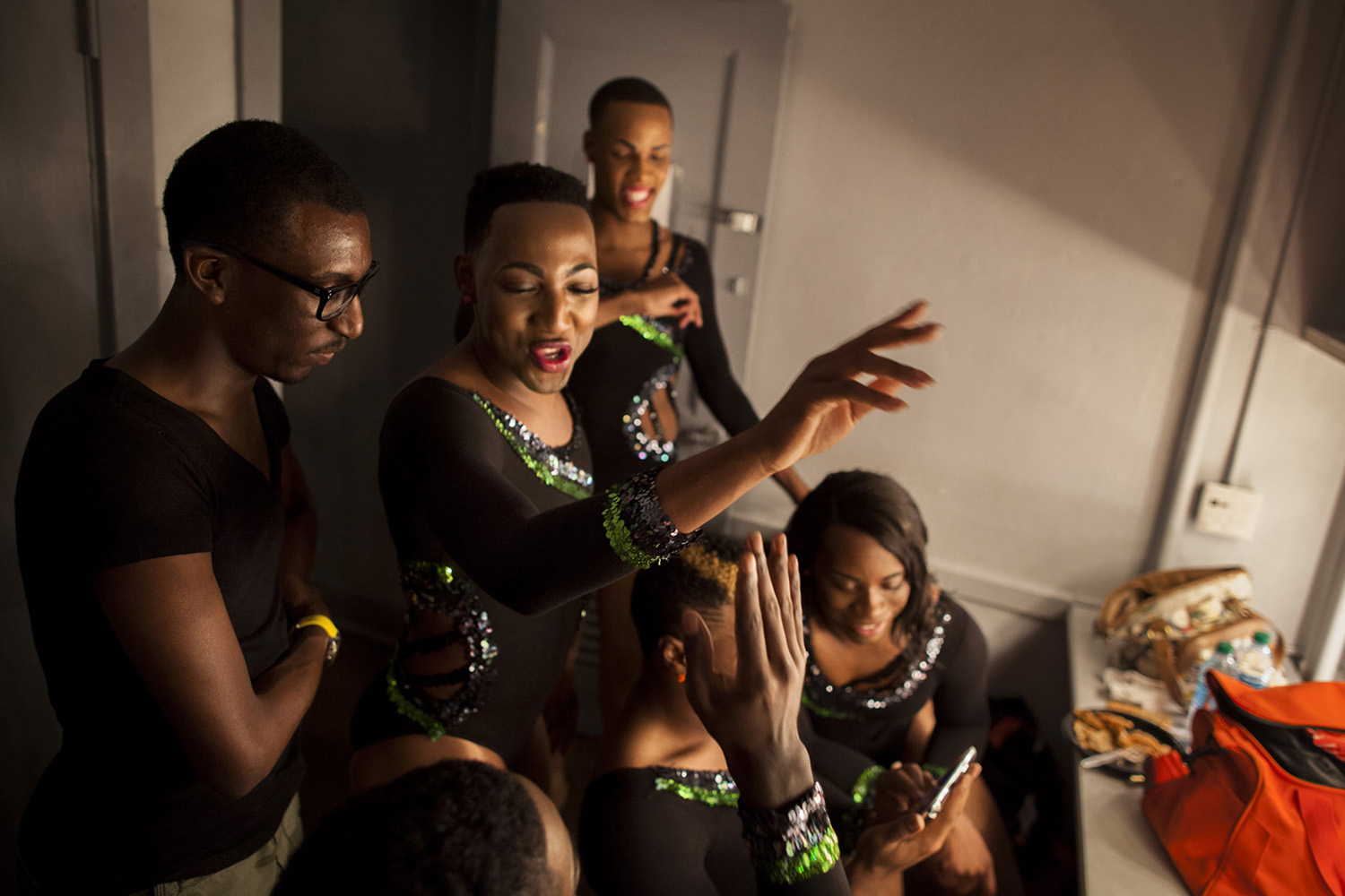 Members of the Prancing Elites and their friends watch videos of their performance at the Saenger Theater in Mobile, Ala.