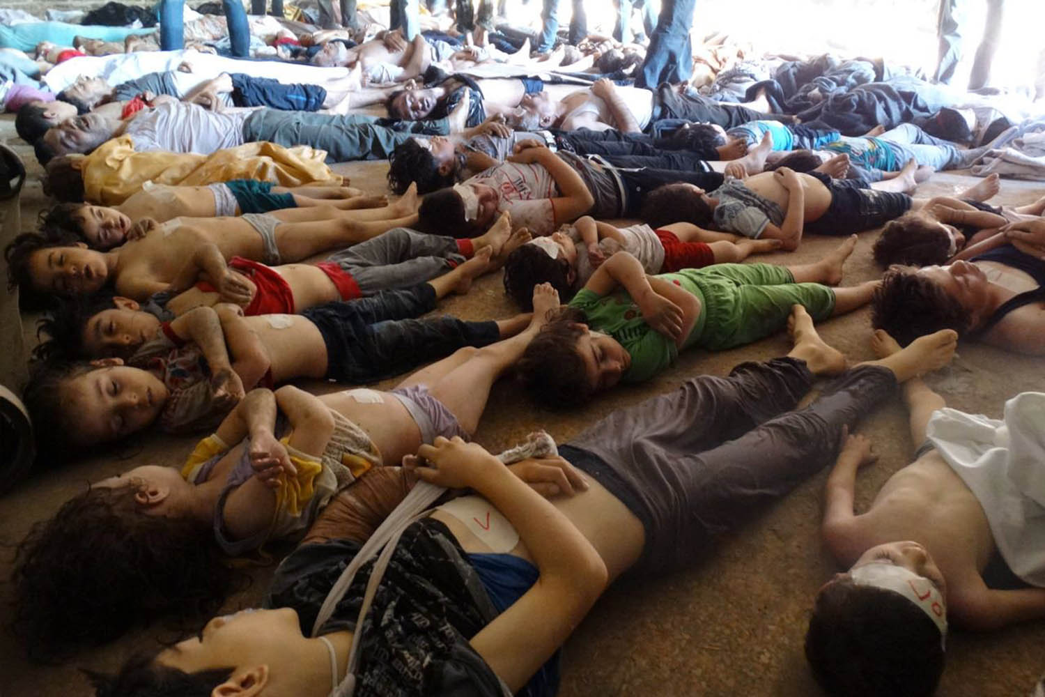 Aug. 21, 2013. This photo released by the Syrian opposition's Shaam News Network shows bodies of children and adults on the ground as Syrian rebels claim they were killed in a toxic gas attack by pro-government forces in eastern Ghouta, on the outskirts of Damascus.