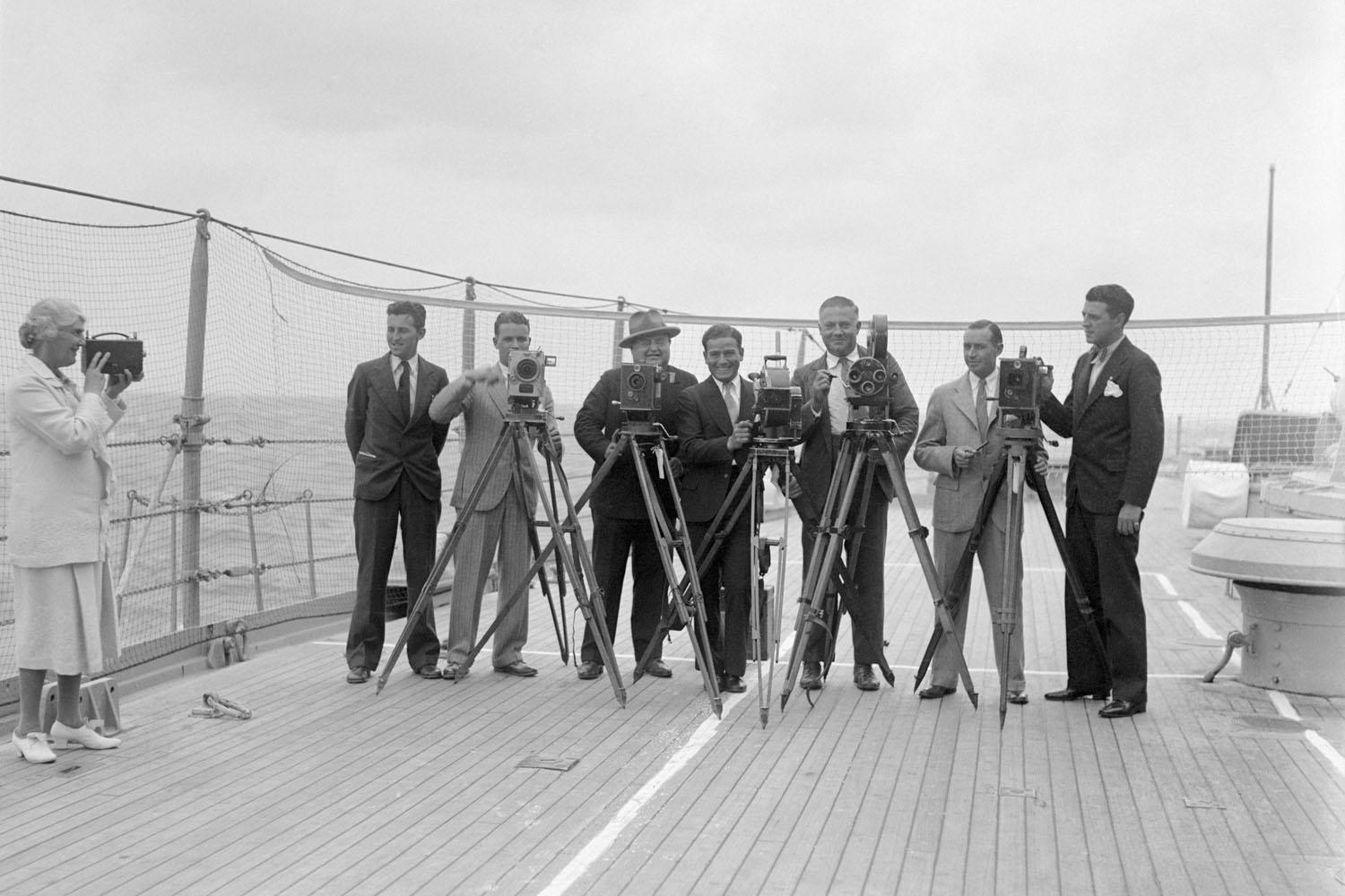 President-elect Herbert Hoover's wife, Lou Henry Hoover, takes a picture of photographers covering Hoover's trip to South America, January 9, 1929.
