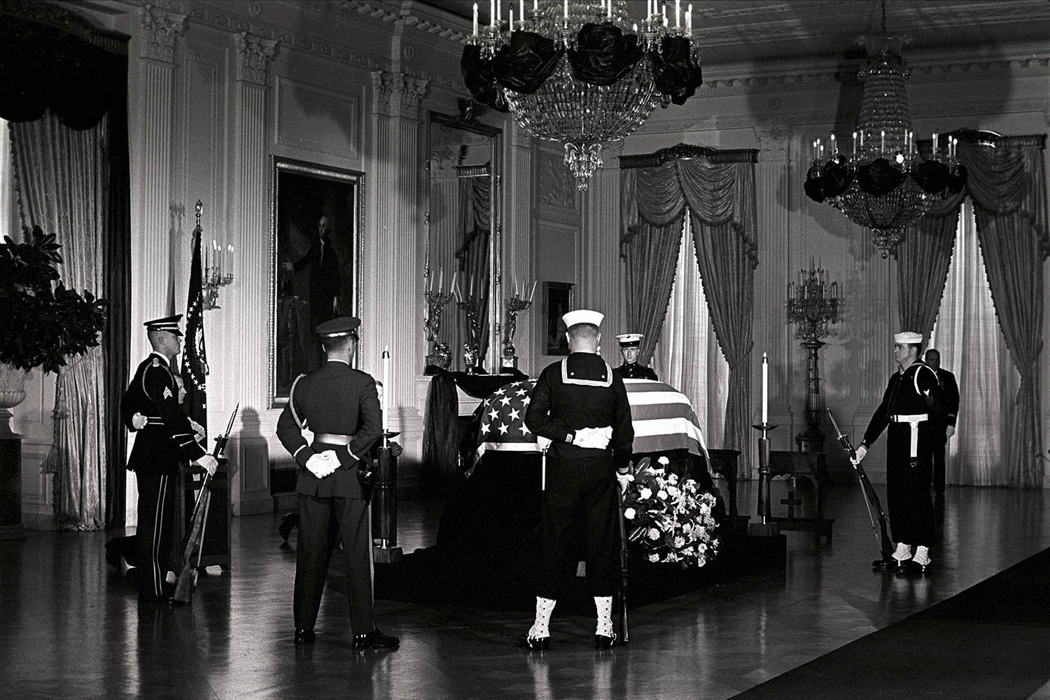 Nov. 23, 1963. In this photo released by the White House, President John F. Kennedy's body lies in state in the East Room of the White House, attended by an honor guard.