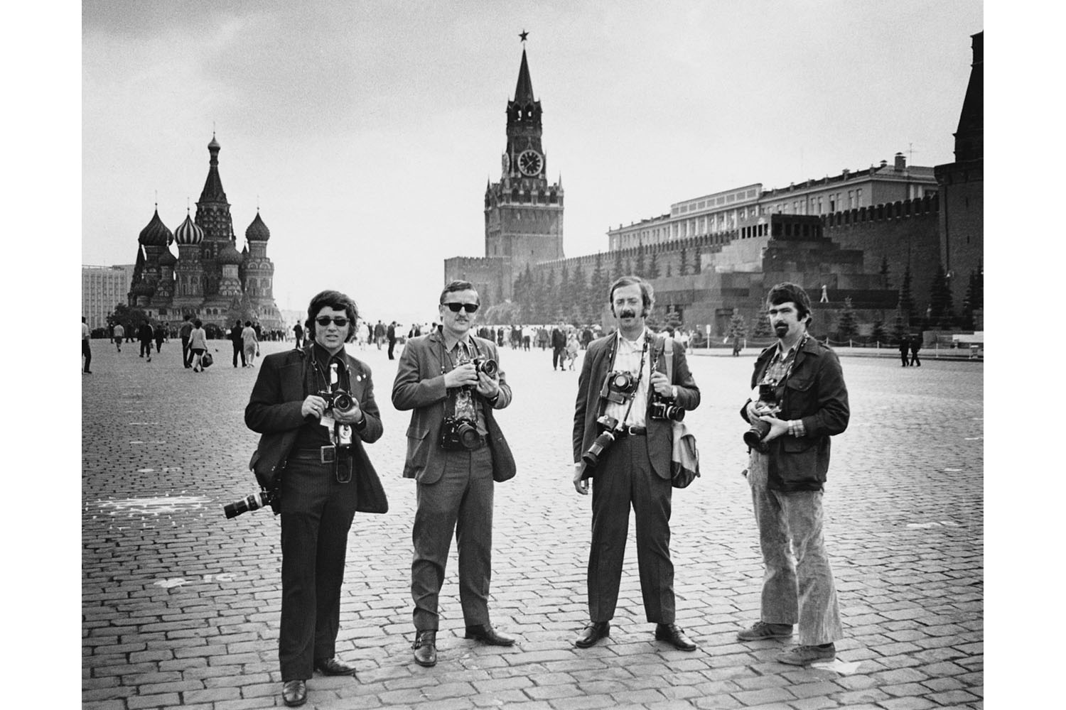 Photographers Darryl Heikes, John Duricker, Wally McNamee, and Chick Harrity stand in Red Square on assignment to cover President Nixon's visit in 1972.