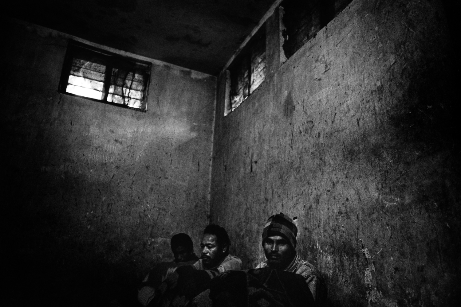 Nepal                                                                                             Poachers sit in a military jail, having been arrested for poaching in Chitwan National Park. They will spend the next twenty years incarcerated.