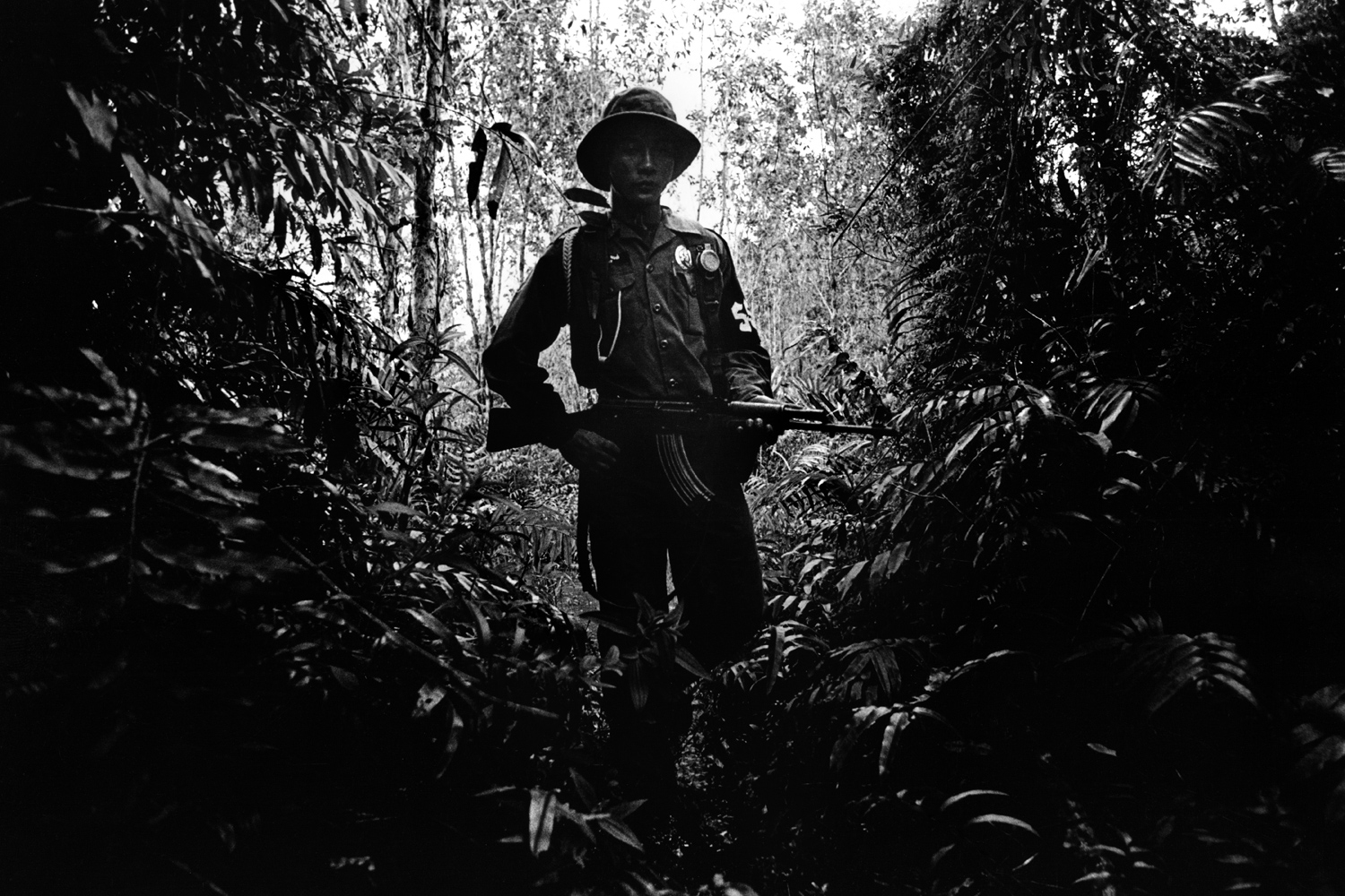 Bokor, Cambodia                                                                                             An armed member of the National Cambodian Forestry Department patrols the Sre Ambel delta region in Bokor National Park, as part of the drive to stop the trade of wildlife that takes place between the hills and the lowlands.