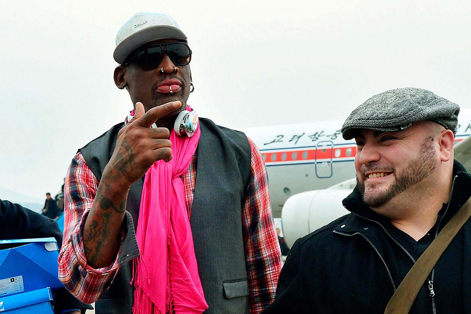 Former NBA basketball star Dennis Rodman (L) arrives at Pyongyang airport in Pyongyang, in this photo released by Kyodo Jan. 6, 2014