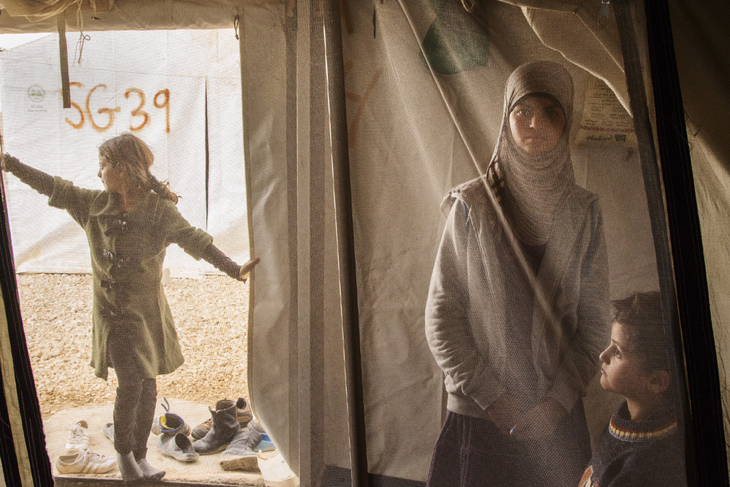 Nov. 18, 2013. Reem, a Syrian refugee suffering from mental health issues spends time with her siblings in her family tent at the Za'atari refugee camp for Syrians, near Mafraq, Jordan.
