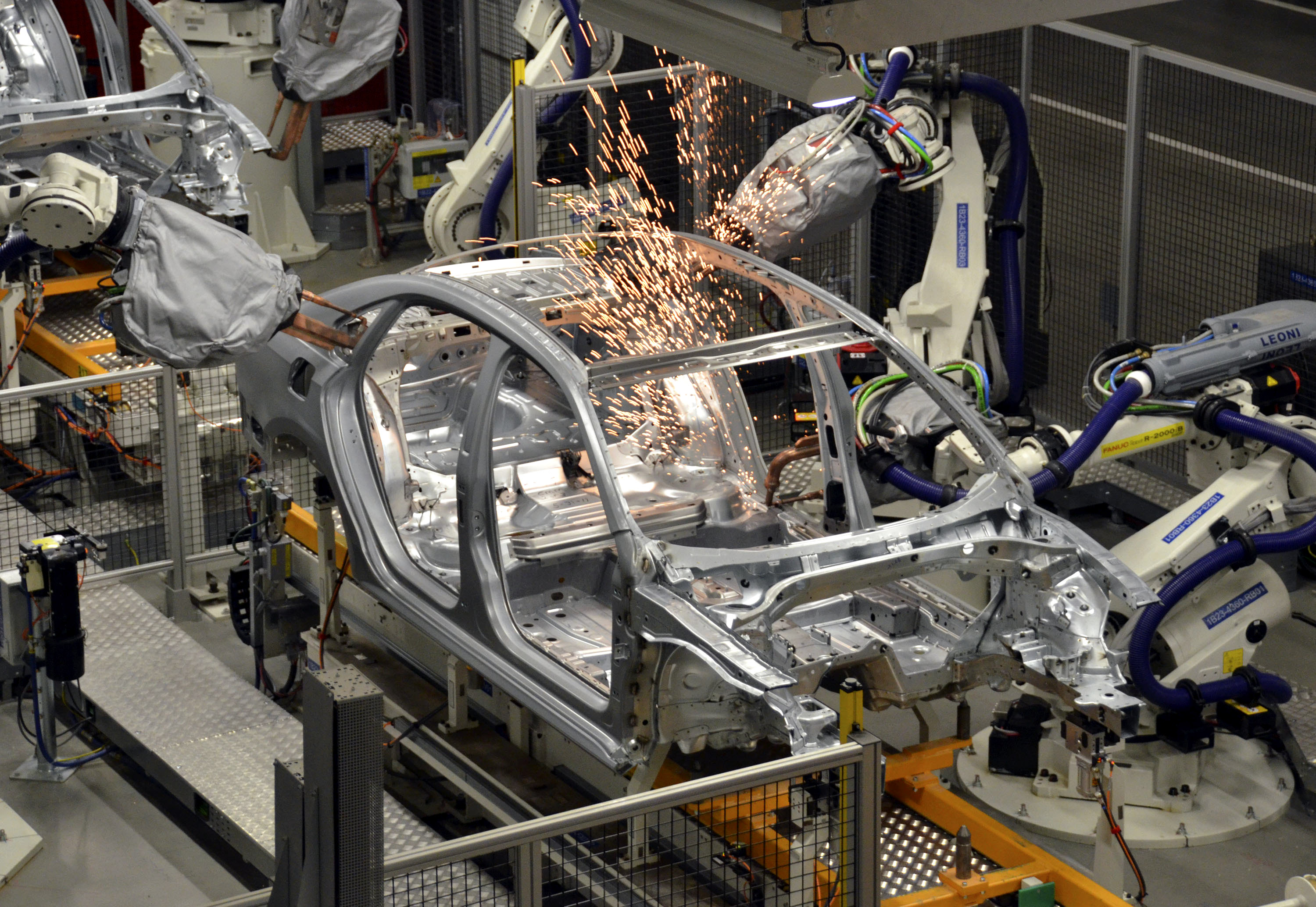 Robots at the Volkswagen Chattanooga plant weld a 2012 VW Passat in the body shop at the plant near Chattanooga, Tennessee, U.S., on Wednesday, June 1, 2011. The plant which has an initial capacity of 125,000 units per year, will build the 2012 Volkswagen Passat for the U.S., Mexico and Canada. Photographer: Mark Elias/Bloomberg