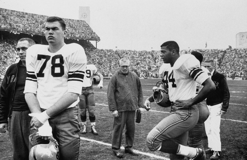 "Syracuse coach Floyd Benjamin ""Ben"" Schwartzwalder and eventual Heisman winner Ernie Davis (#44) during the 1960 Cotton Bowl against Texas."