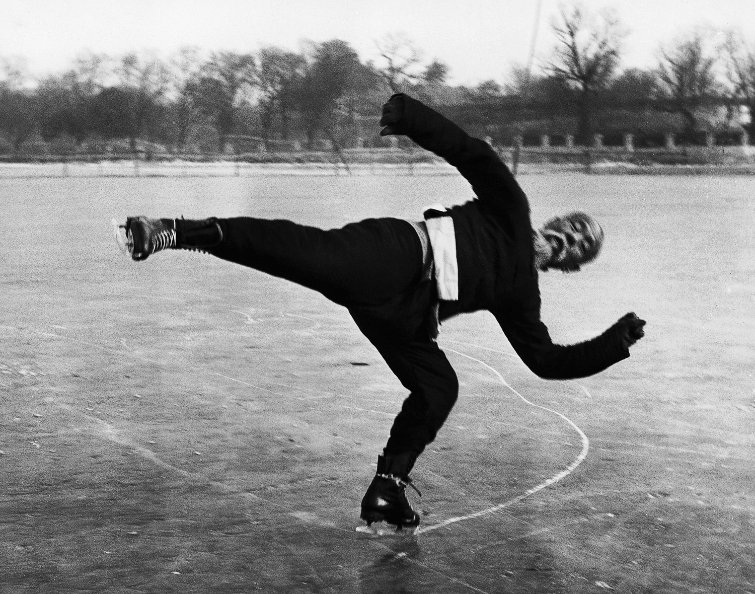 Caption from LIFE.  Mr. Wu Tang-shen does Chinese version of American skaters' Charlotte Stop. He is good but a little old-fashioned.