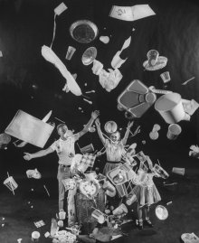 """A man, woman and child toss """"disposable"""" items into the air, 1955."""