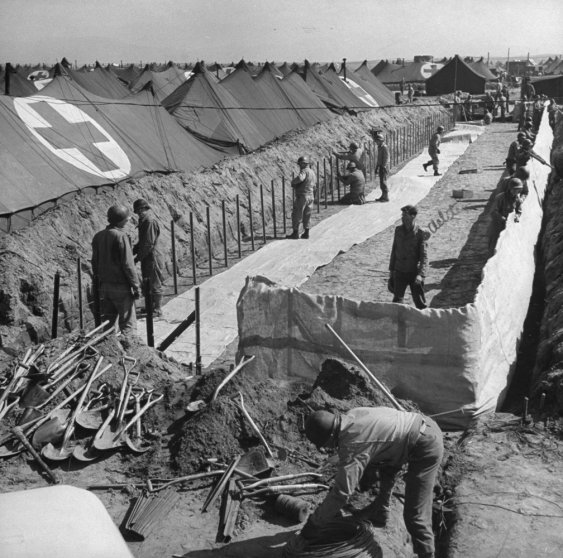 American hospital ward tents being erected below ground level for protection from enemy shelling, Anzio, 1944.
