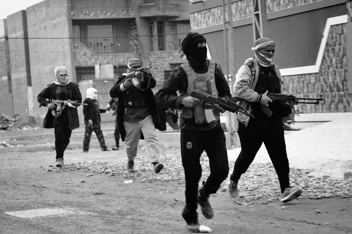 Tribal fighters patrol Fallujah streets on Jan. 5 as the Iraqi government faces off against al-Qaeda forces