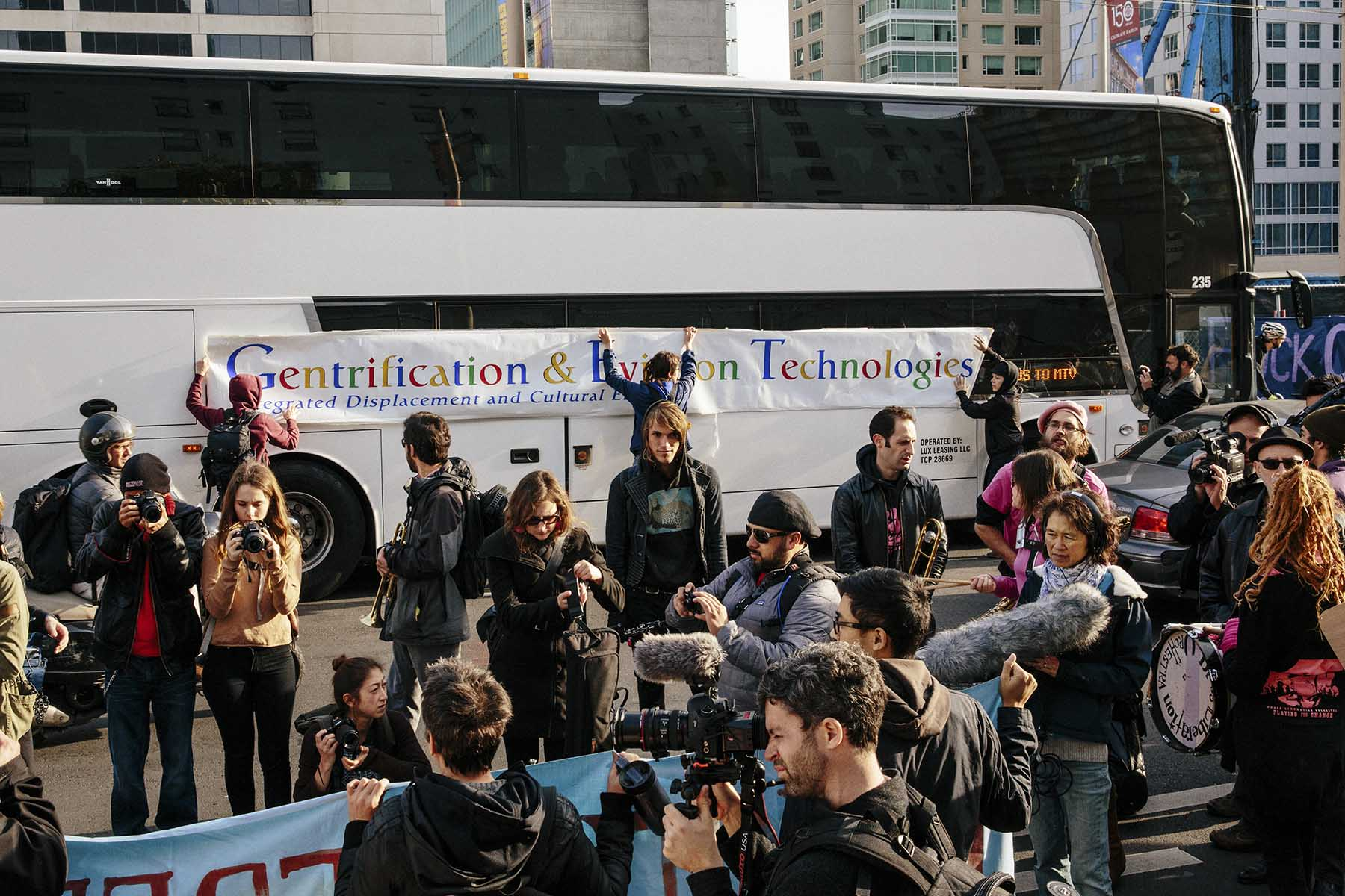 Protesters who blame tech wealth for San Francisco's soaring housing costs blockade a private shuttle filled with Google employees.