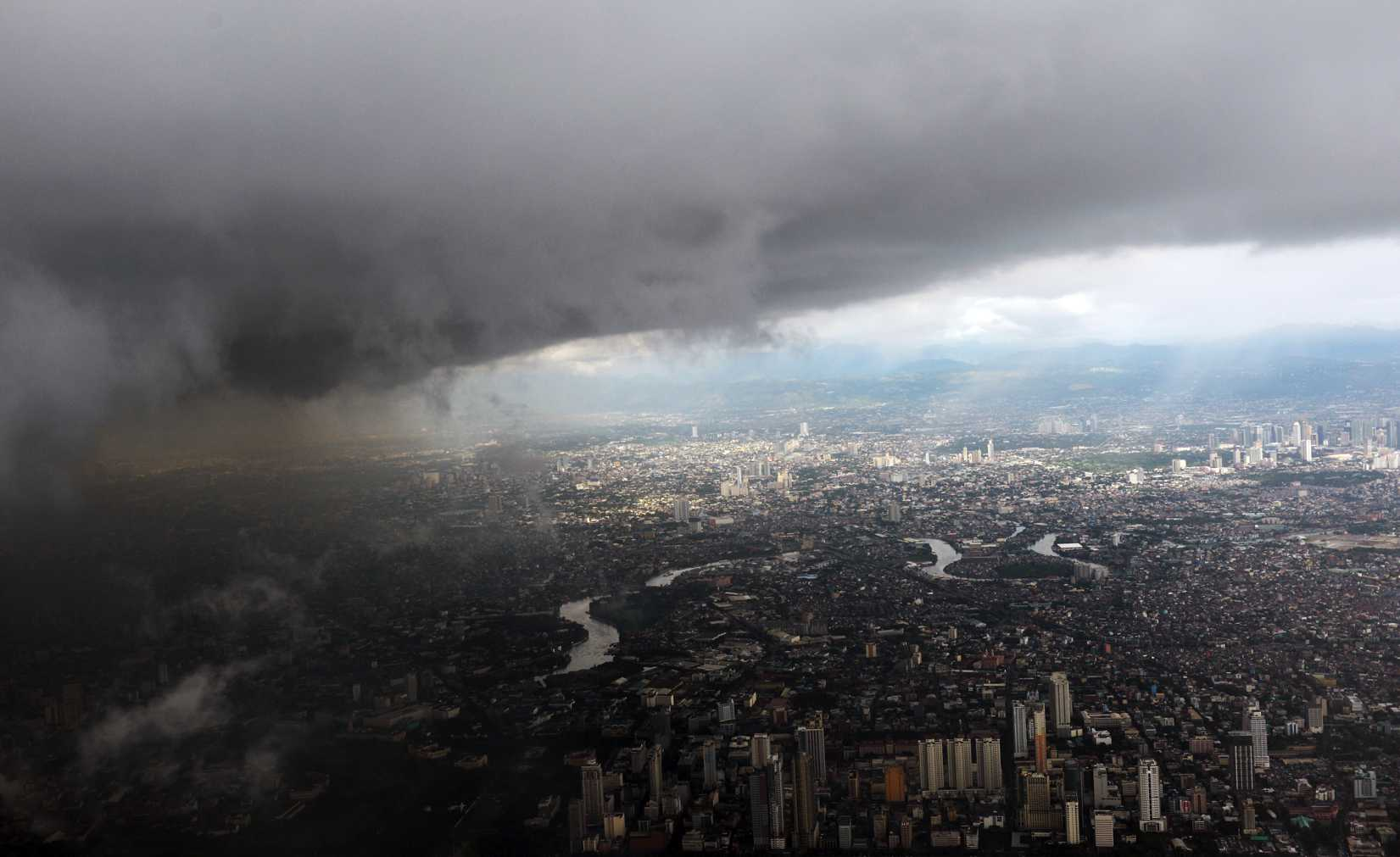 An aerial shot shows clouds above Manila on December 23, 2013.