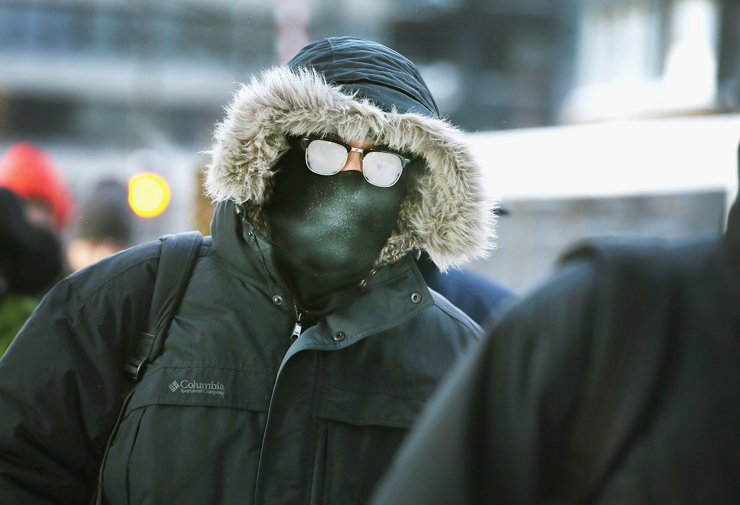 Commuters make a sub-zero trek to offices in the Loop on Jan. 6, 2014 in Chicago, Ill.