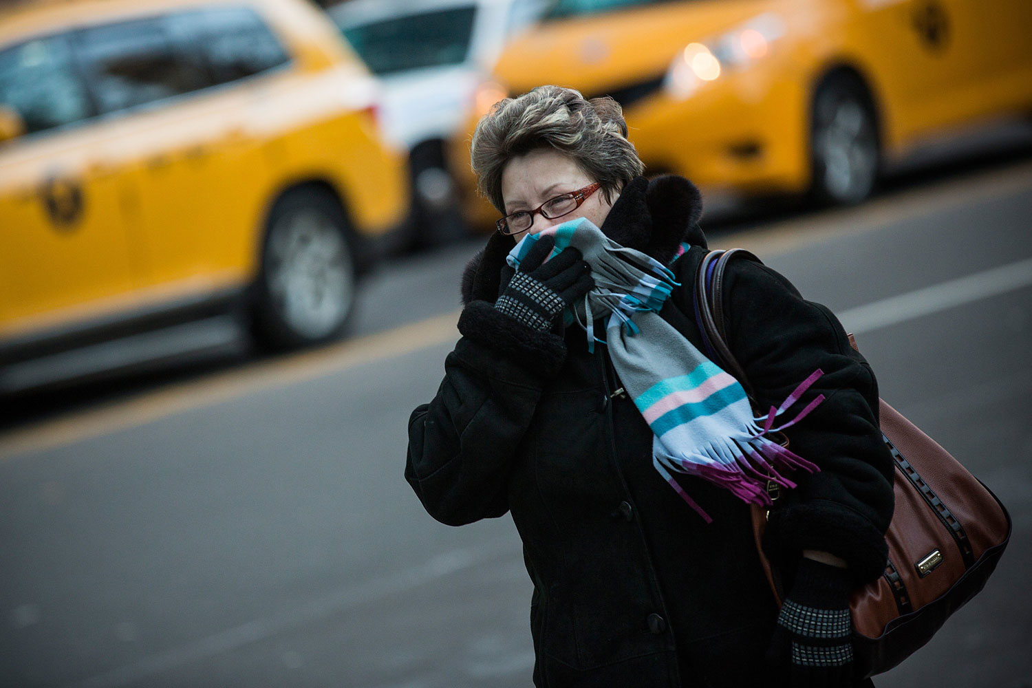 A woman bundles up against the cold on the afternoon of Jan. 8, 2014 in New York City.