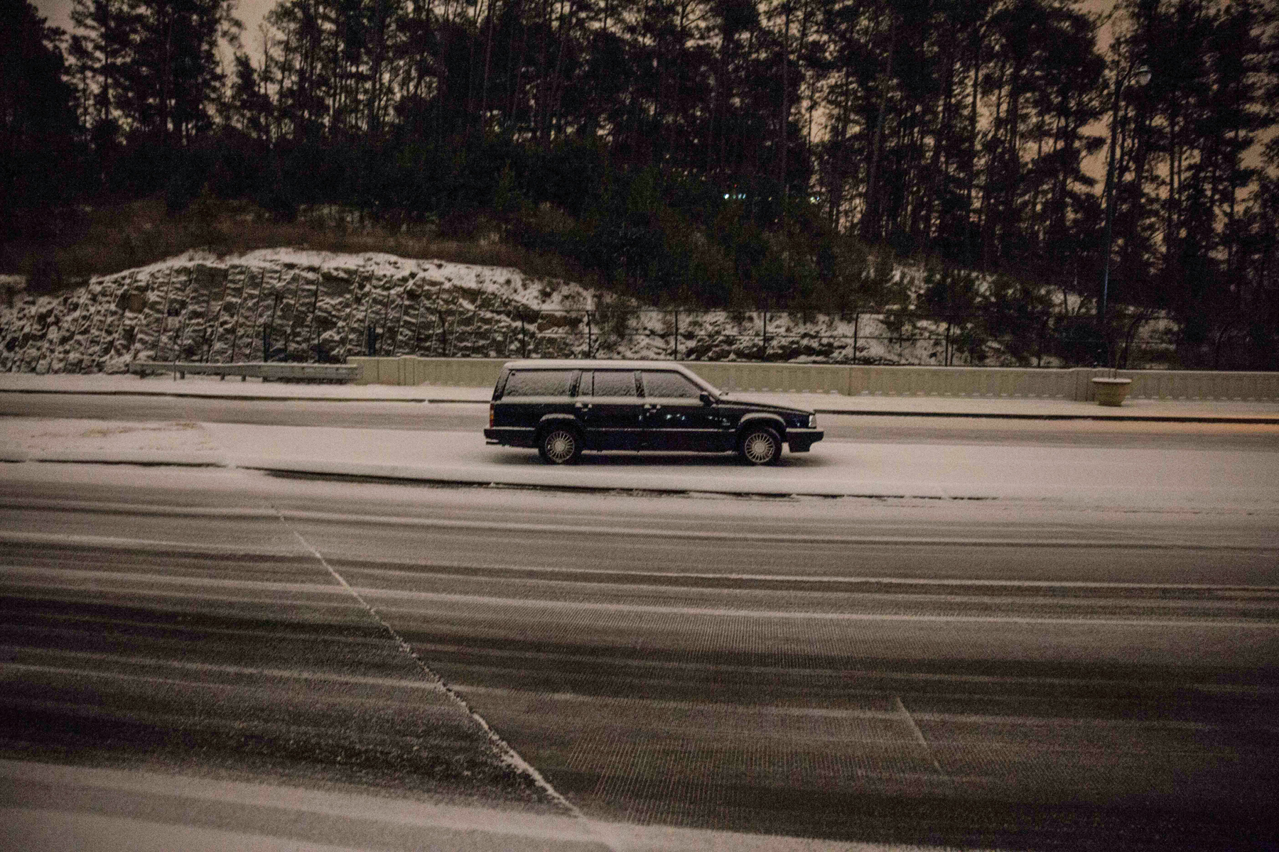 A car sits abandoned on Peachtree Center Parkway, Tuesday evening, Jan. 28, 2014, in Dunwoody, Ga.