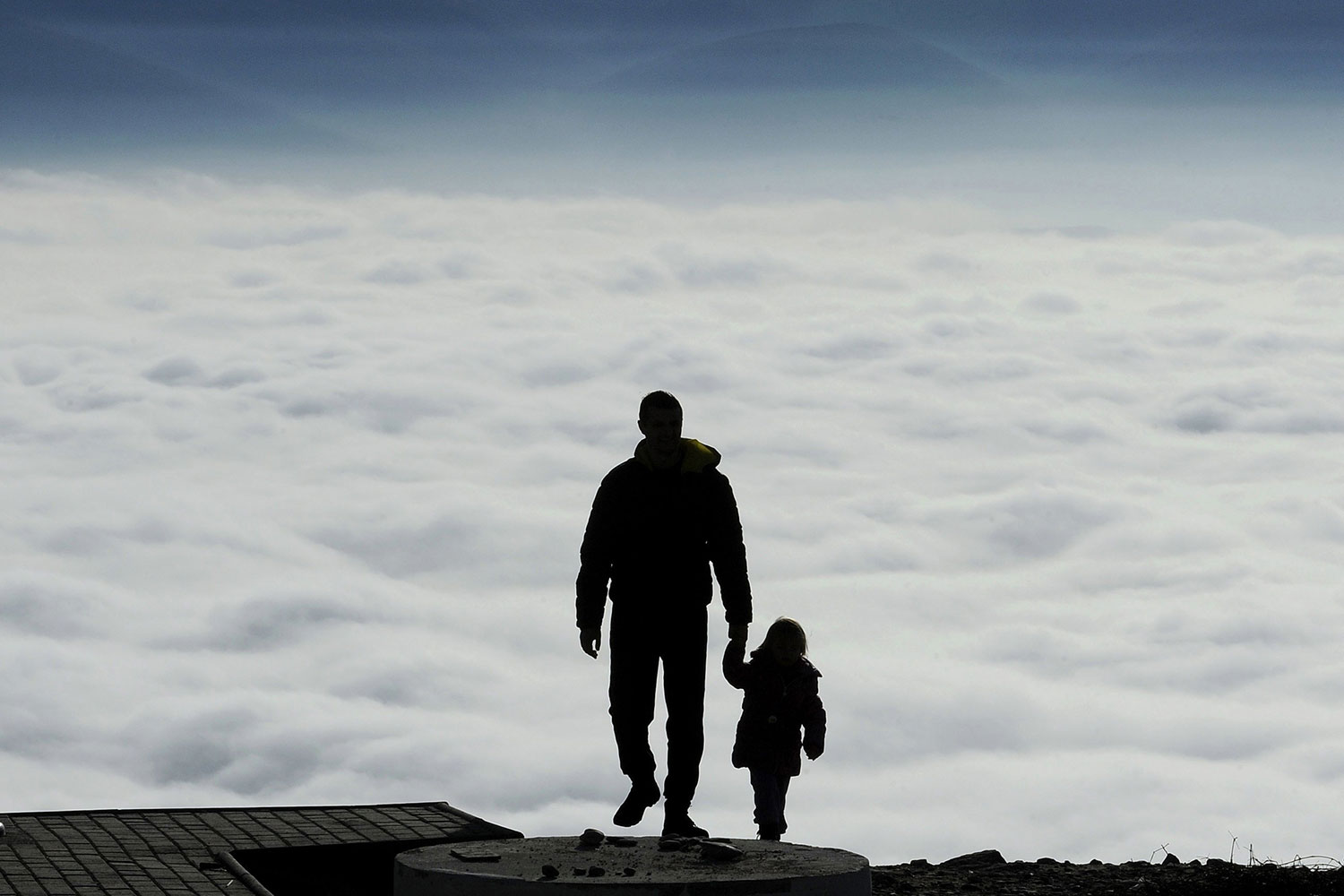 Jan. 9, 2014. A man with a child walks towards the top of Vodno Mountain in Skopje, Macedonia.