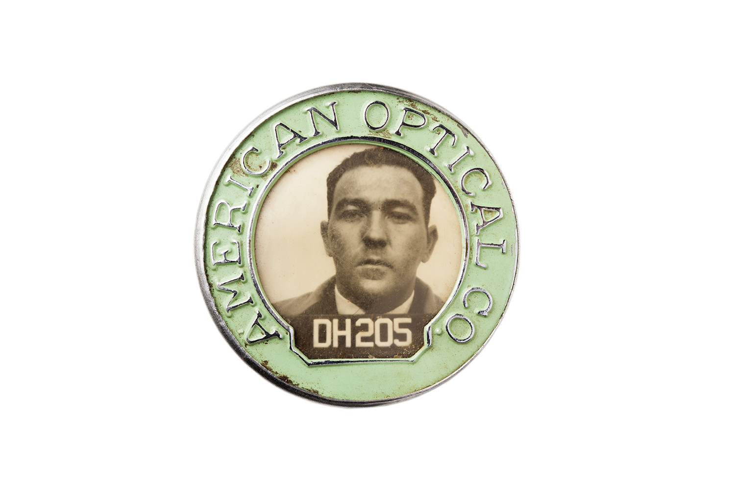 The ID badge of an employee at the American Optical Co.