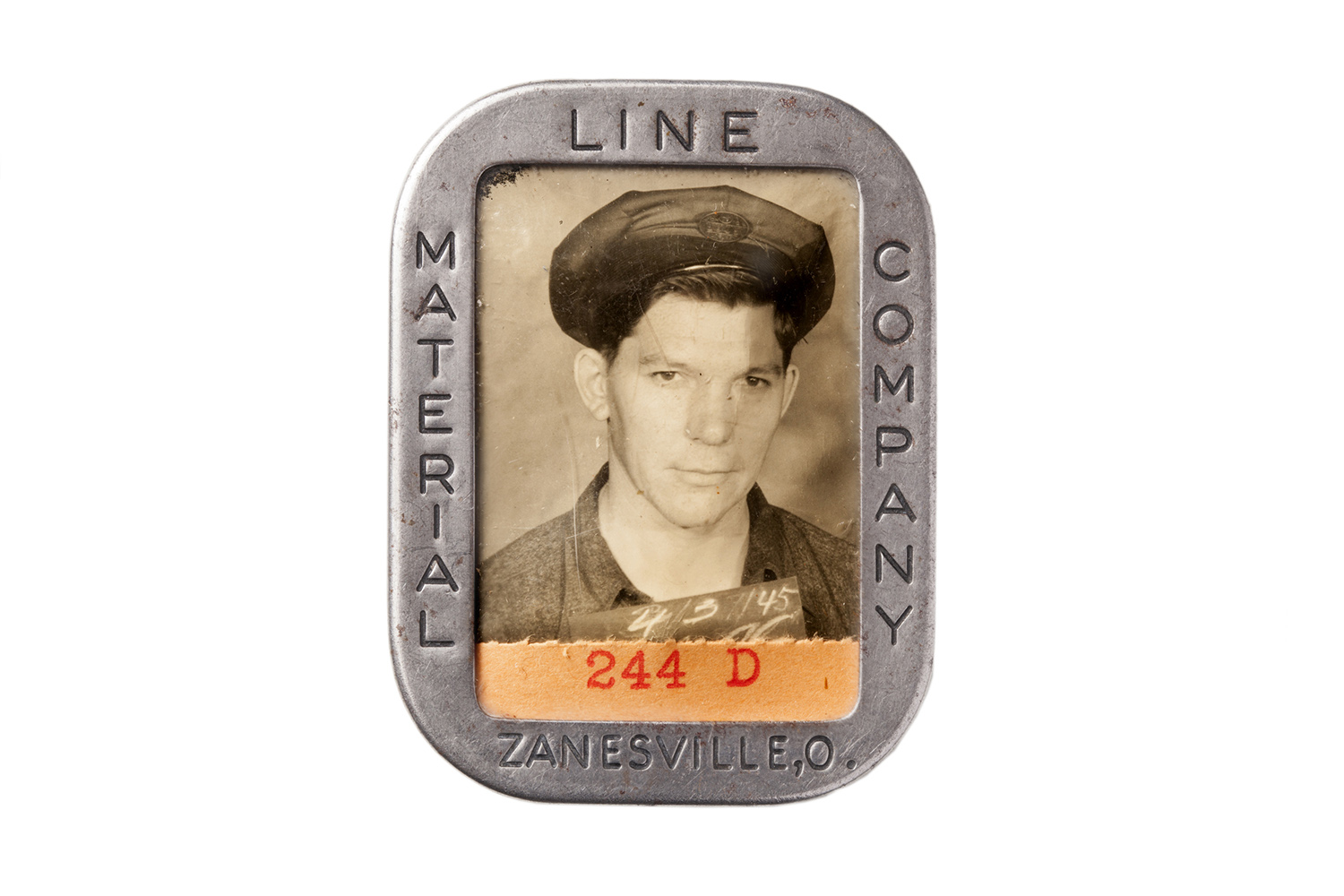 The ID badge of an employee at the Material Line Company.