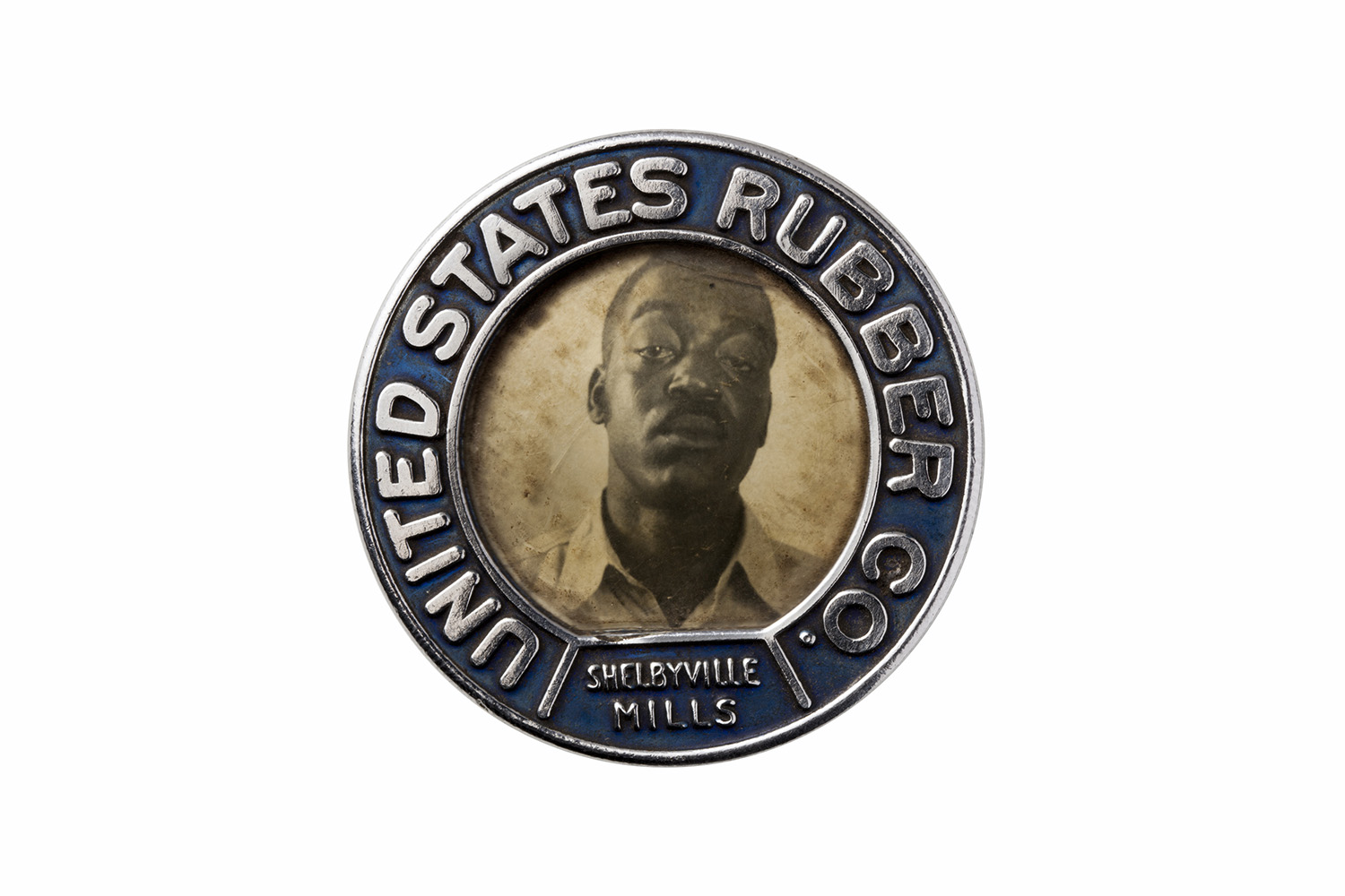 The ID badge of an employee at the United States Rubber Co.