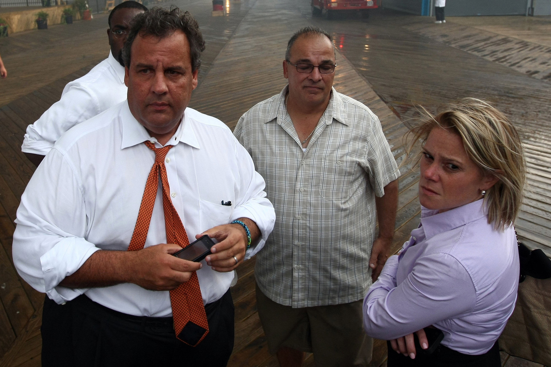 In this Sept. 12, 2013, file photo provided by the Office of the Governor of New Jersey, Deputy Chief of Staff Bridget Anne Kelly, right, stands with Gov. Chris Christie, left, during a tour of the Seaside Heights, N.J., boardwalk after it was hit by a massive fire