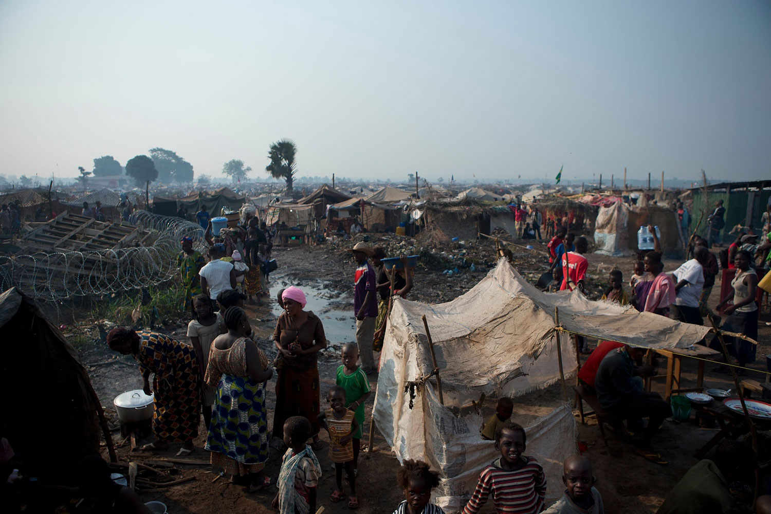 People displaced by violence attempt to create a semblance of daily life in a sprawling camp at M'Poko International Airport in Bangui on Jan. 2, 2014.