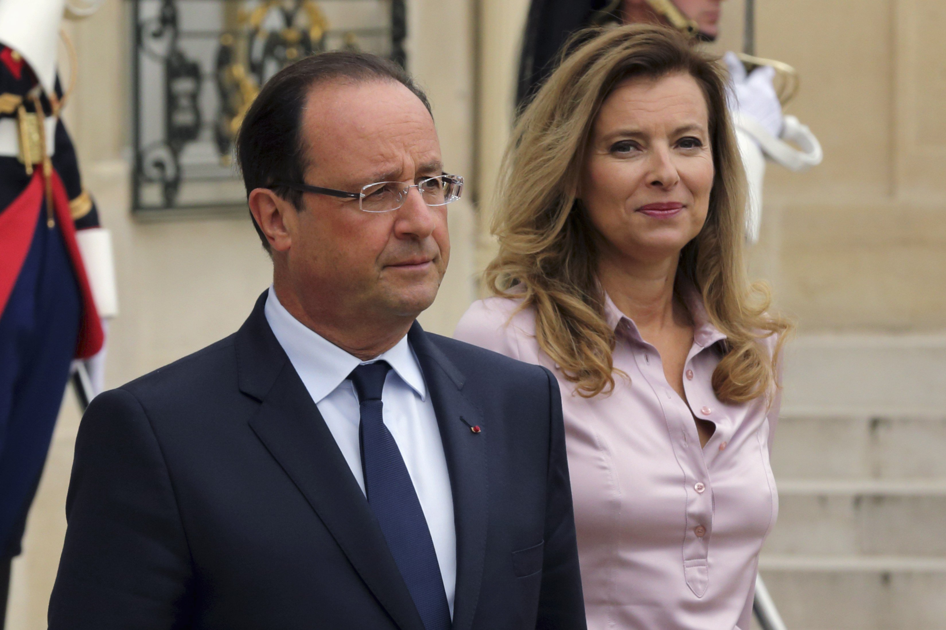 French President François Hollande and Valérie Trierweiler accompany guests following a meeting at the Élysée Palace in Paris on Oct. 1, 2013