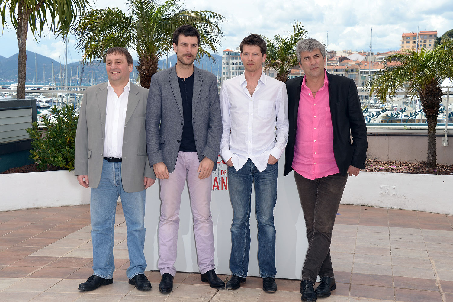 Actors Patrick d'Assumcao, Christophe Paou, Pierre Deladonchamps and director Alain Guiraudie attend the photocall for 'L'Inconnu Du Lac' (Stranger by the Lake) during the 66th Annual Cannes Film Festival at Palais des Festivals on May 17, 2013 in Cannes, France