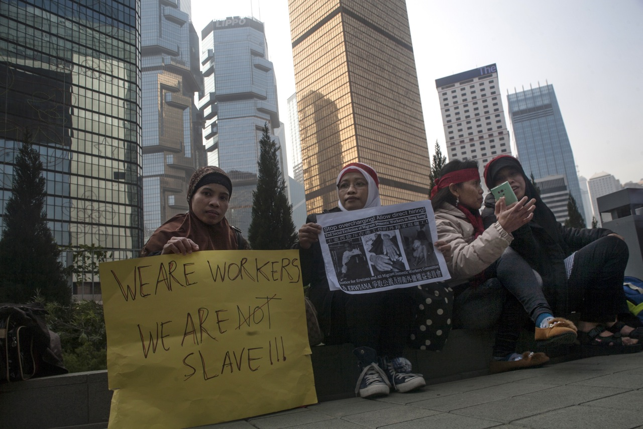 Indonesian migrant workers, from left, Khasmira and Mimi protest the alleged abuse of Erwiana Sulistyaningsih in Hong Kong on Jan. 19, 2014