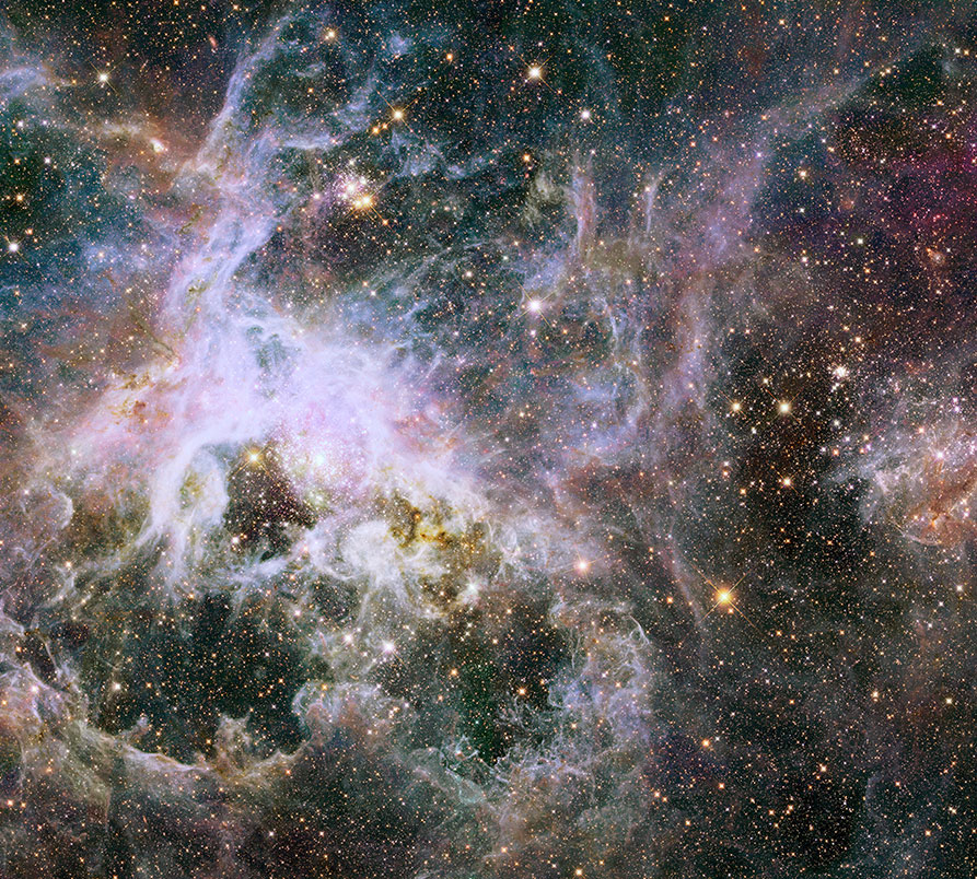 NASA's Hubble Space Telescope has captured a new view deep inside the Tarantula Nebula, where there are more than 800,000 stars and protostars. Also known as 30 Doradus, the Tarantula Nebula is a raucous region of star birth that resides 170,000 light-years away in the Large Magellanic Cloud, a small, satellite galaxy of our Milky Way.
