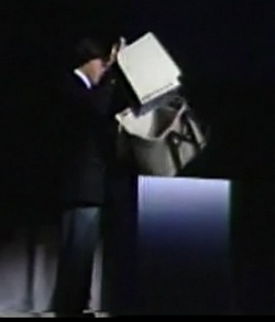 Steve Jobs removes the Mac from its case at the BCS meeting