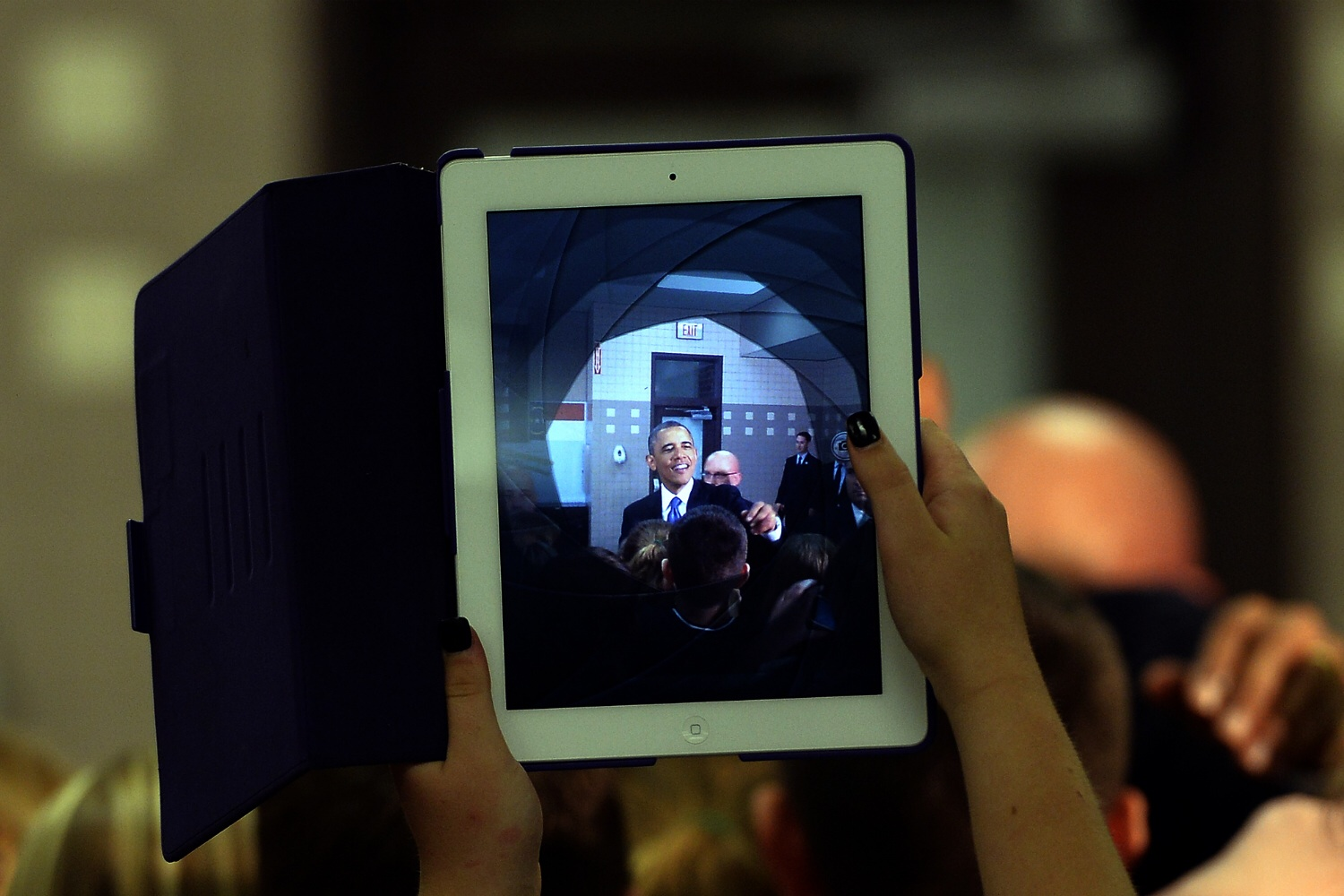 A student at Mooresville Middle School in Mooresville, North Carolina takes a photo of President Barack Obama on an iPad on June 6, 2013