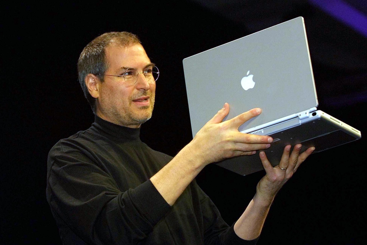 Steve Jobs shows off Apple's PowerBook G4 at Macworld Expo in San Francisco on January 9, 2001