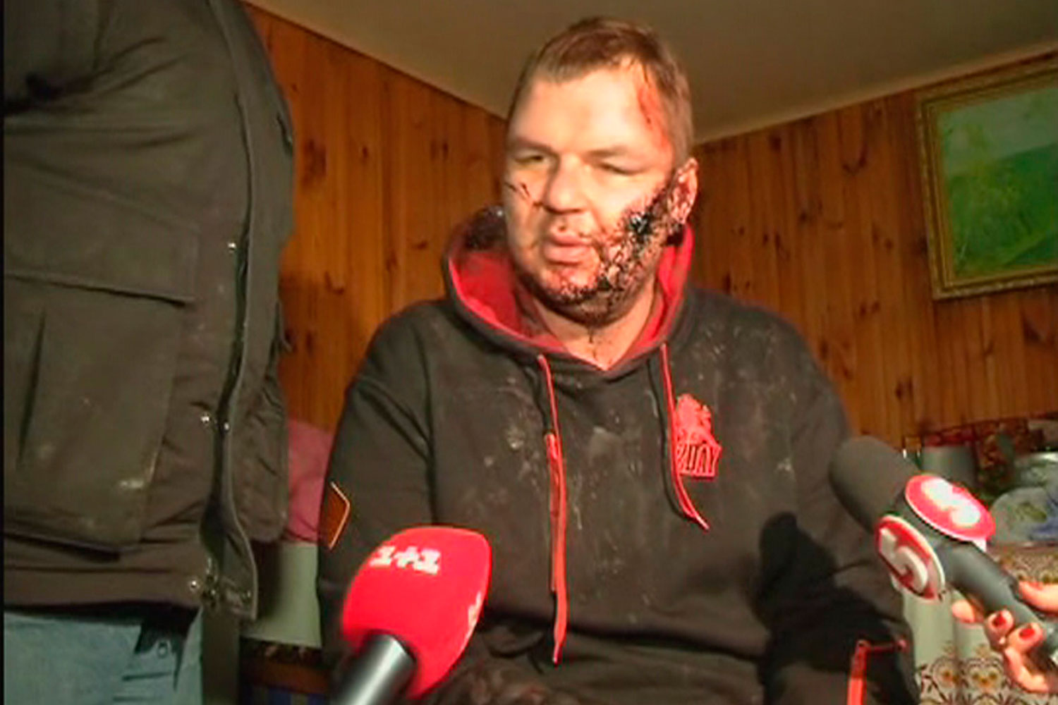 Dmytro Bulatov, 35, one of the leaders of anti-government protest motorcades called 'Automaidan', speaks to journalists after being found near Kiev, Jan. 30, 2014.