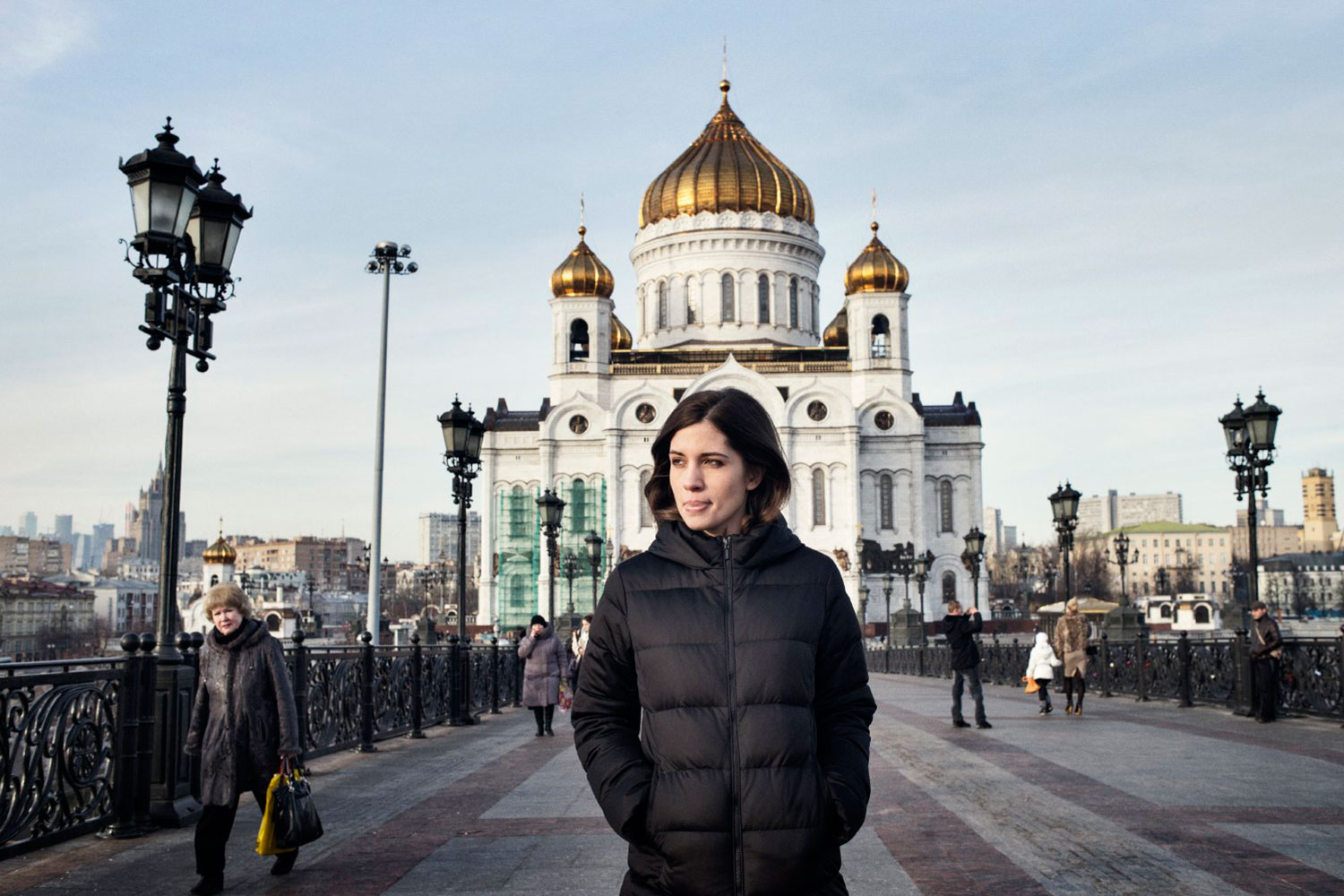 """Nadezhda Tolokonnikova  in front of Christ the Saviour Cathedral in Moscow. Their two-year sentence, on charges of """"hooliganism motivated by religious hatred"""" for performing a protest song in this cathedral, was commuted under an amnesty from the Kremlin."""