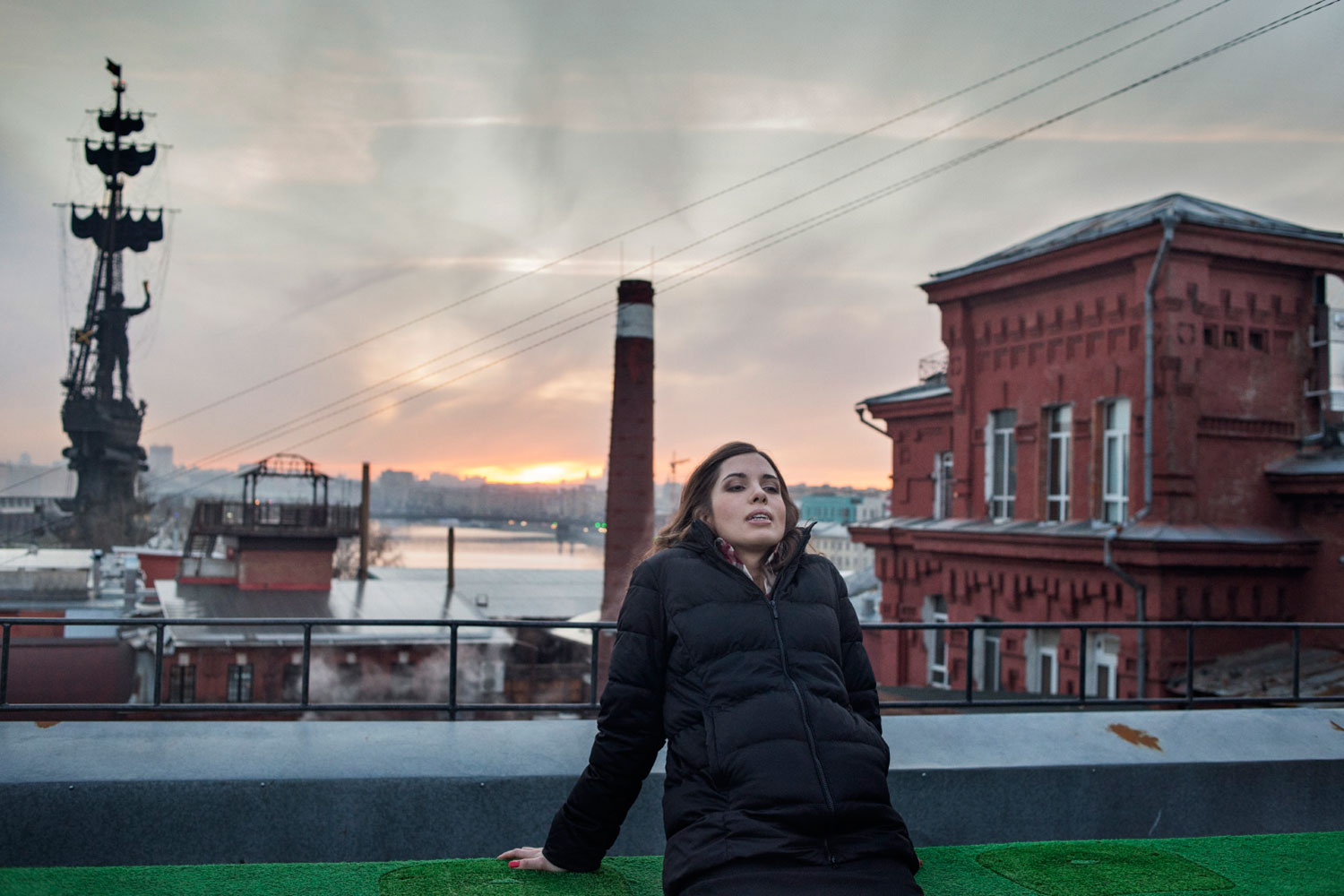 Nadezhda Tolokonnikova takes a break on the roof of a Moscow TV station after she and Maria Alyokhina gave their first news conference.