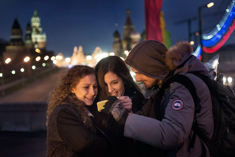 Maria Alyokhina, Pyotr Verzilov and Nadezhda Tolokonnikova check Twitter.