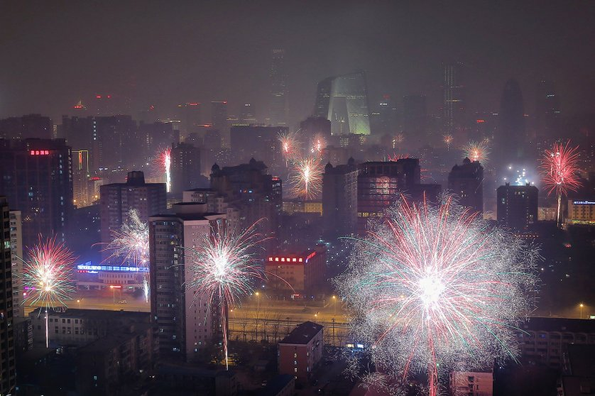Fireworks illuminate the skyline to celebrate Chinese Lunar New Year of Horse and cause severe air pollution on Jan. 30, 2014 in Beijing.