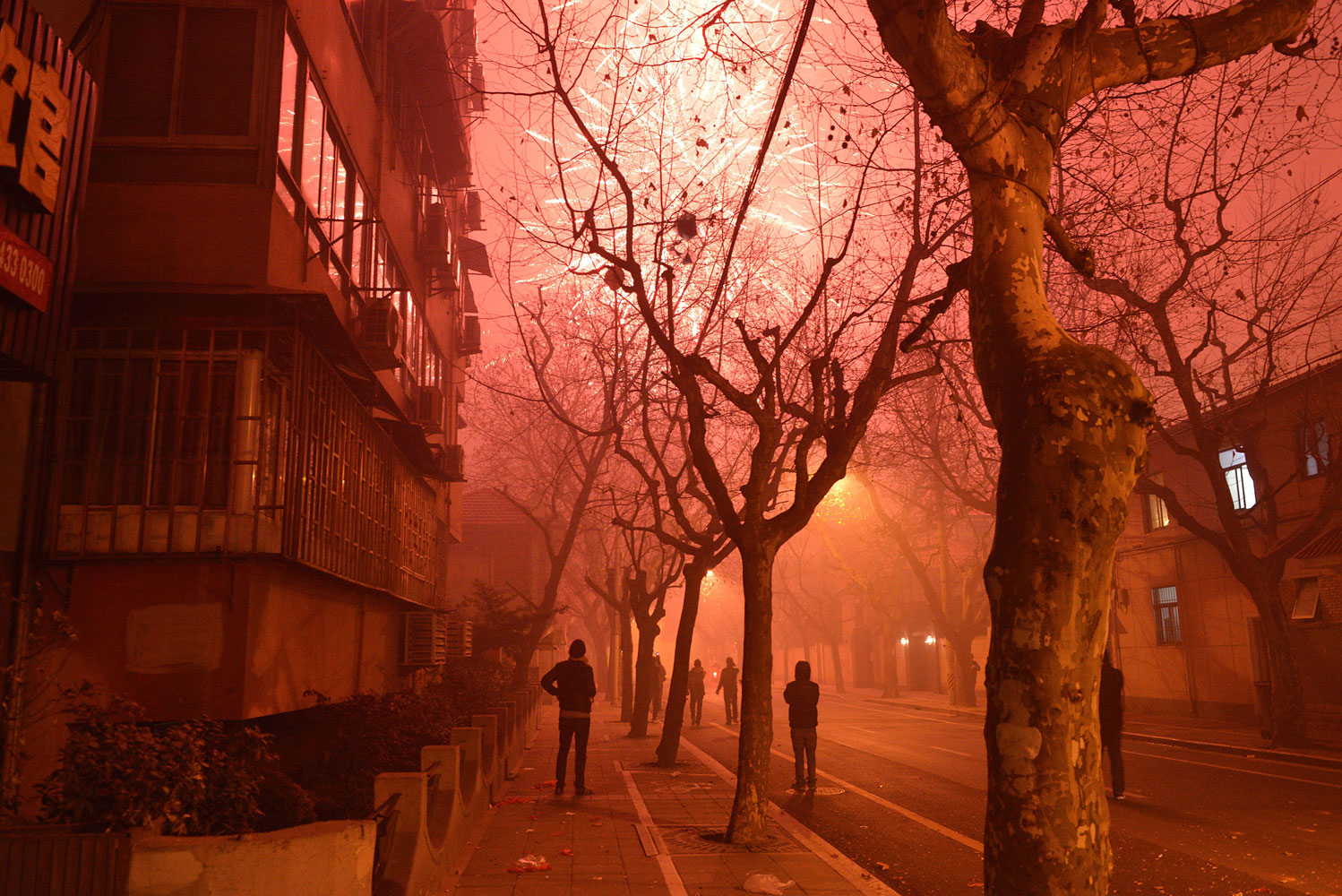 Fireworks explode in a street of Shanghai on the eve of Chinese New Year on Jan. 30, 2014.