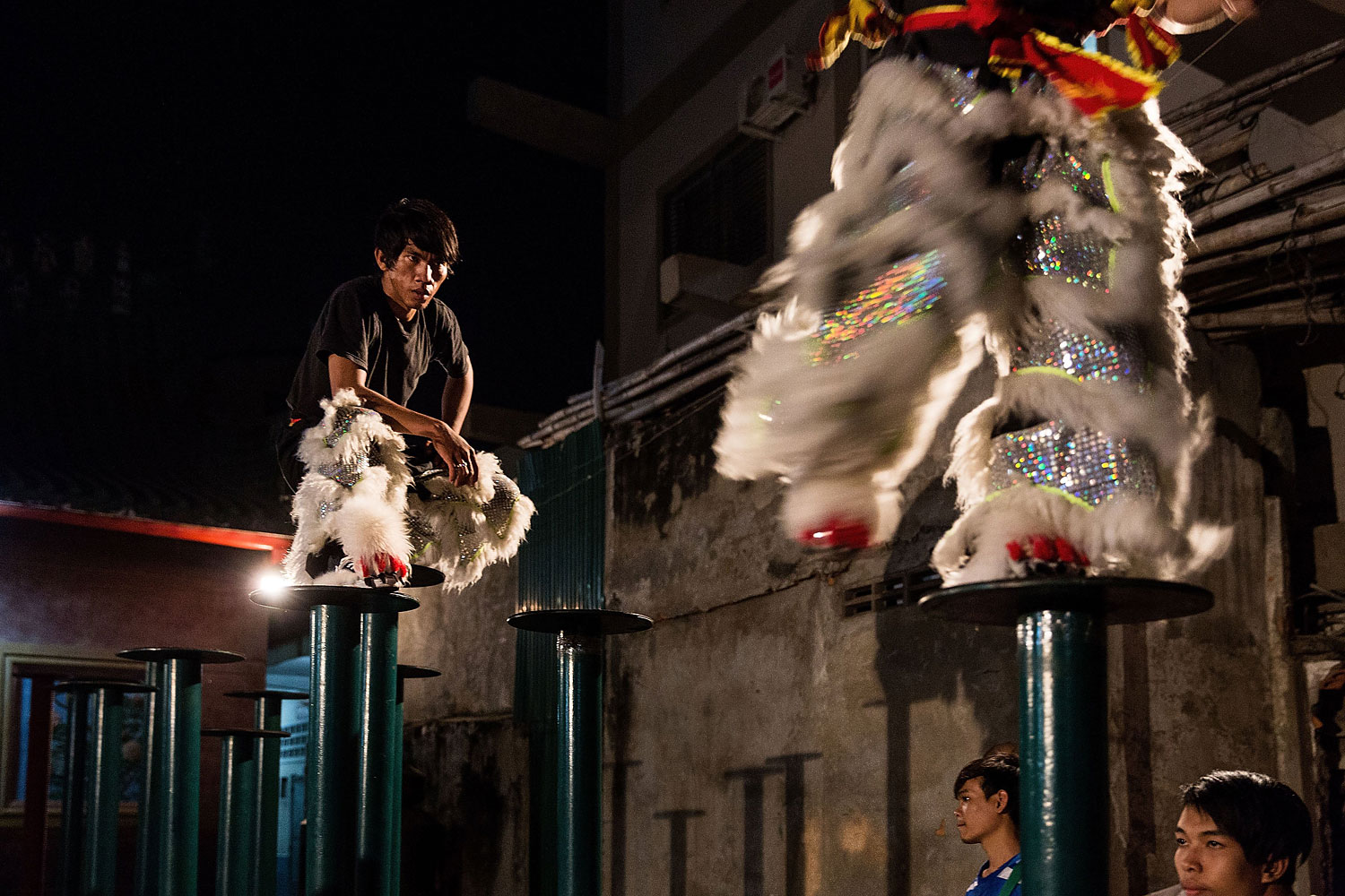 A Lion Dancer takes a break during a practice session on Jan. 29, 2014 in Phnom Penh, Cambodia.