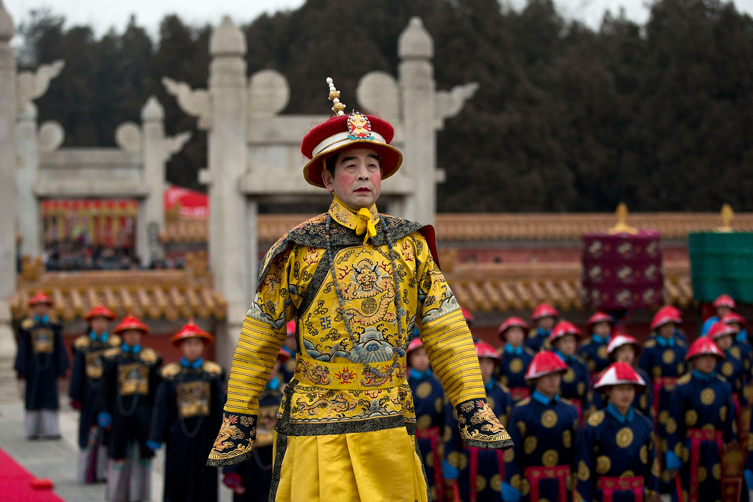 A man dressed as a Qing Dynasty emperor performs in a reenactment of an imperial ritual ceremony praying for good harvest in the coming year at the Temple of Earth park on the Spring Festival in Beijing Jan. 31, 2014.