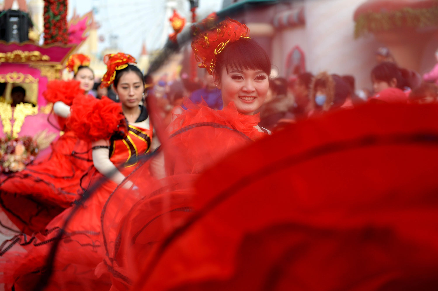 Performers dance during a temple fair to celebrate the Spring Festival, or the Chinese Lunar New Year, in Beijing, Jan. 31, 2014.