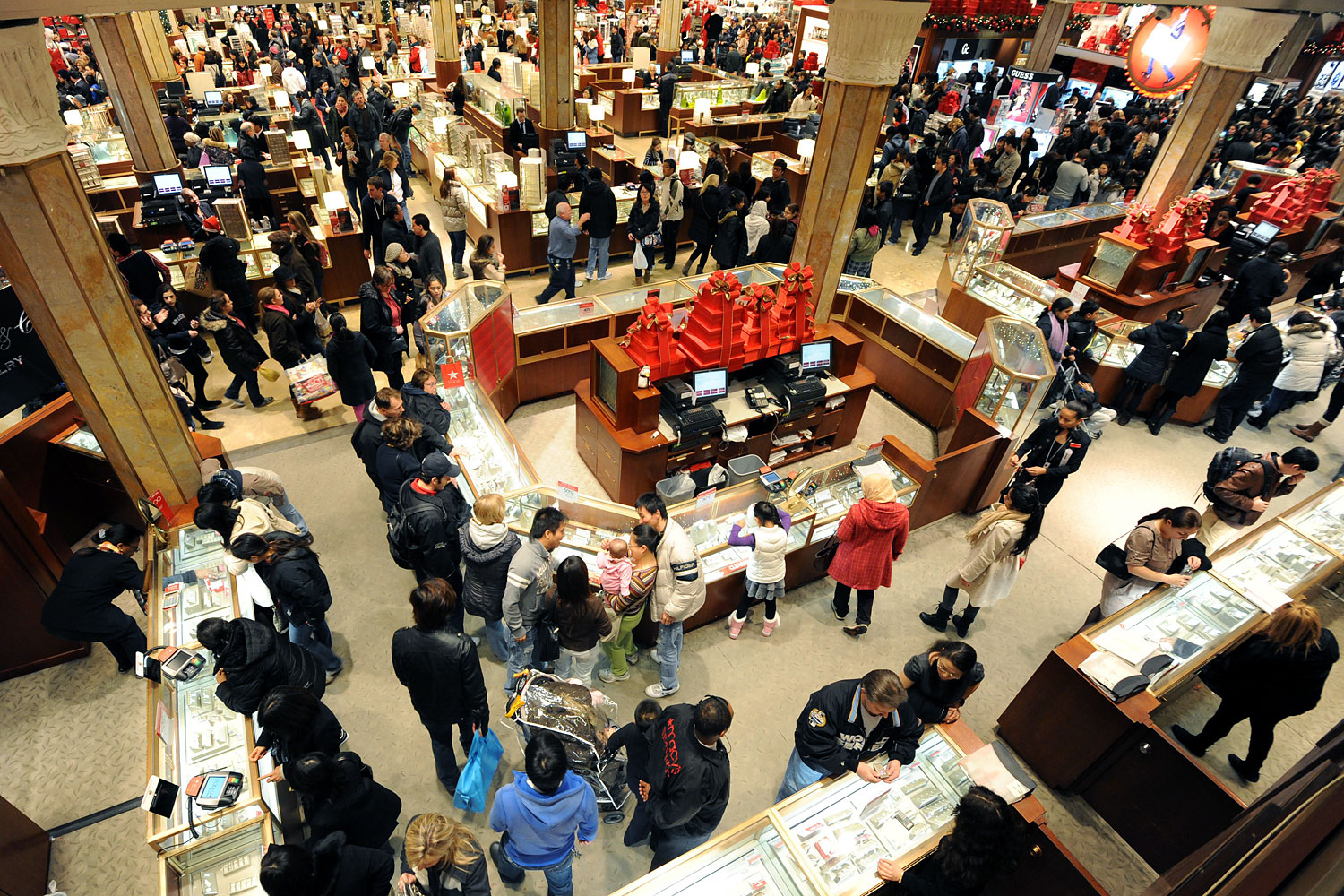 People crowd the aisles inside Macy's department store on Nov. 25, 2011 in New York after the midnight opening to begin the  Black Friday  shopping weekend.