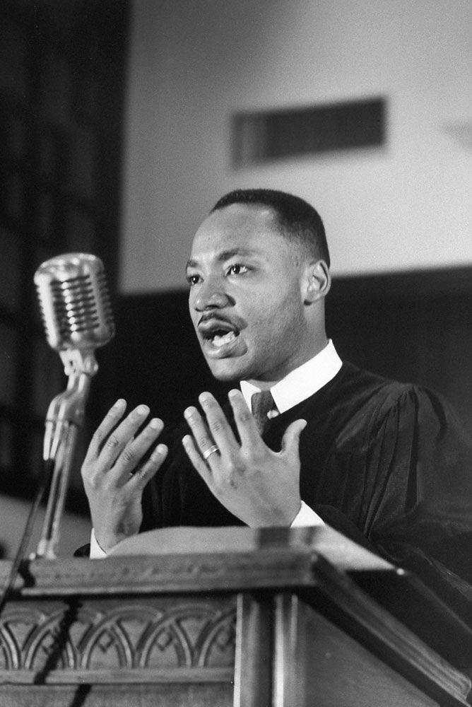 Civil Rights activist Rev. Dr. Martin Luther King Jr. gives a sermon at Ebenezer Baptist Church.