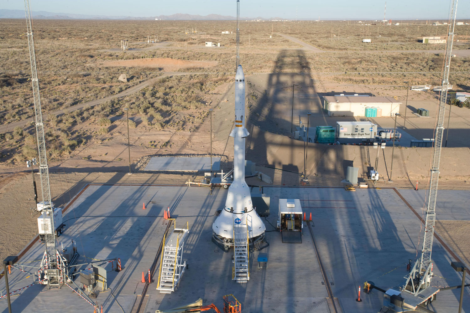 The launch-abort rockets and an Orion mock-up are prepared on the pad for their test flight at the U.S. Army's White Sands Missile Range in New Mexico, on April 8, 2010.
